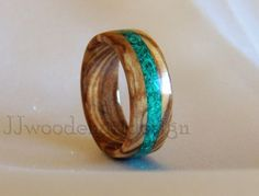 Rings made from Mediteranean - Croatian olive wood. My Wedding, Engagement, Anniversary, Gift rings I make from very old olive wood from my fathers olive garden.  I put turquoise, malachite and other stone inlay. Each ring is polished and coated with several layers of durable glass finish.  All of my rings are hand made. Once I receive your order it will take 3-5 business days to produce your ring and ship it. When you order please indicate in your message to the seller the size and width…