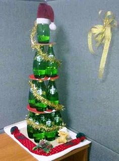 Christmas Tree of Recycled Perrier Bottles & Cardboard: 17 Perrier Bottles (330ml) 3 Cardboard's (as dividers) Few Deco. to Complete it. Simple as it is.