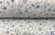 Tela Piqué de Canutillo Blanco con Flores Azules