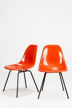 Eames orange shell chairs... Kinda makes you wanna run through all the places you went as a child and see if they still have any of these left... school, doctors offices, libraries...
