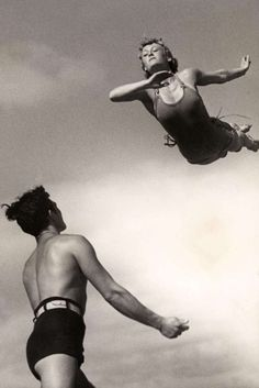 Bodies in Motion...Woman in Mid-air with Man Waiting to Catch Her, 1937