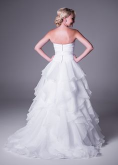 Strapless wedding dress with organza ruffle skirt