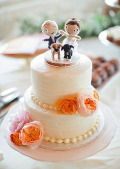 Characters of couple and their dogs as cake topper.