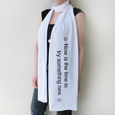 """Now you won't have to wait until the end of the lo mein before you discover your fortune. With a message that reads """"now is the time to try something new,"""" the Giant Fortune Scarf by Xenotees wraps around your neck, all but guaranteeing a lucky day."""
