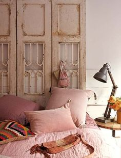 Re-claimed doors as a feature and headboard