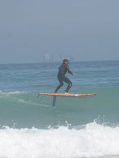 SUP Foiling is the next big thing in stand up paddle boarding. Foil-Smart SUP SURF foil in action. Capetown, South Africa