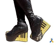 Elton John's Platform Boots auctioned for charity to raise money for Amnesty International.