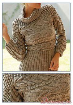 Женский пуловер, связанный на спицах в поперечном направлении.