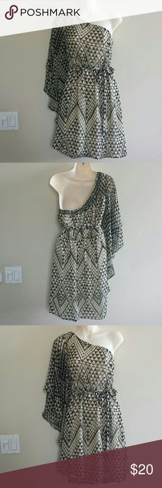Medium One Shoulder Dress Beautiful one shoulder dress with a cascading sleeve. No holes or snags. This dress is a head turner. Dresses One Shoulder