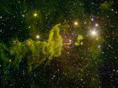 "A nebula known as ""the Spider"" glows fluorescent green in an infrared image from NASA's Spitzer Space Telescope and the Two Micron All Sky Survey (2MASS)."