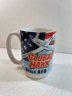 Vintage Global Hawk Beale AFB Coffee Mug with American Flag & Plane Made in USA 4.5 Inches Tall 4.5 Inches Wide with Handle Holds 14 Ounces Vintage Kitchen, American Flag, Plane, Air Force, I Shop, Hold On, Coffee Mugs, Handle, Stamp