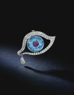 The Eye of Time, 1949-1951    Platinum, diamond, ruby and blue enamel brooch with a mechanical Movado watch movement (7 cm) by the jewelers Alemany & Ertman, New York.