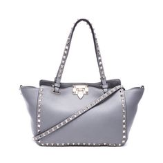 "Valentino Rockstud Gray Small Tote Rock your everyday look with this signature stud-trimmed Valentino tote in a smaller size. Valentino grainy calfskin mini tote with platino hardware. Signature Rockstud pyramid stud embellishment. Flat tote handles; 7"" drop. Removable shoulder strap; 19"" drop. Open top with with flip-lock closure. Interior zip panel; unlined. Metal feet protect bag bottom. 6 1/2""H x 14""W x 4""D. Bag weighs approx. 1lb. Made in Italy. Unfortunately doesn't come with strap…"