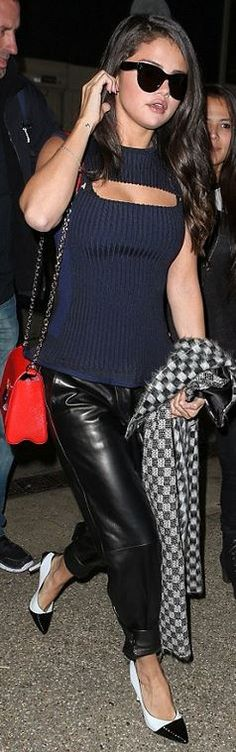 Who made  Selena Gomez's black sunglasses, blue cut out top, red handbag, leather pants, and red handbag?