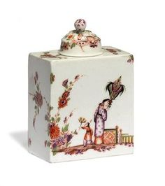 A MEISSEN CHINOISERIE RECTANGULAR TEACADDY AND A COVER  CIRCA 1735, THE COVER LATER, BLUE CROSSED SWORDS MARK TO BASE, DREHER'S ./-/.. MARK  Painted in the manner of Johann Ehrenfried Stadler, each side with an Oriental with an attendant child, one figure holding a parasol, the other with a fan, standing by fences and flowering shrubs extending to the ends of the caddy, the domed cover similarly decorated below a pink bud finial  4 7/8 in. (12.4 cm.) high (2)