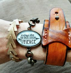My favorite combo! Dixie bracelet (gold triangle)- $18, Drew bracelet (w/ Shakespeare quote) -$16, & Pippa cuff (leather cuff)- $16 available on my website www.plunderdesign.com/candice84 Plunder Design Jewelry. Vintage jewelry. Vintage inspired jewelry. Dixie bracelet. Leather cuff. Shakespeare quote. Though she but little she is fierce.