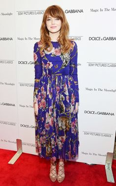 Emma Stone looking flawless in a long sleeve, crew neck floral print midi dress and strappy heels