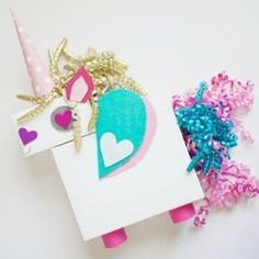 "How cute is this Unicorn by the Craft Box Girls? There's nothing sweeter than little love notes for Valentine's Day! The classic ""shoebox stuffed with classroom Valentines"" has come a long way, and today we're sharing 30 of the cutest Valentine's Day Card Box Holder Ideas with you to inspire your own mailbox creation for February 14th."