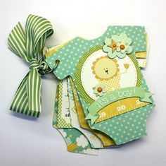"""Hello! Shellye here today with a simply sweet """"onesie"""" shaped mini album using the new """"It's A Boy"""" Collection and the """"Outfitting Baby"""" cut file from Silhouette. To get started, I altered the cut fil"""