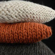 Chunky knit pillows.  I like the idea of one being the knit side and one being the purl side.