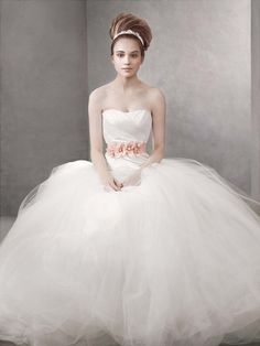 A dash of pink brings romance. White by Vera Wang