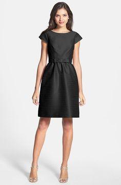Loving this black bridesmaid dress with petite bow sash.   See more preppy bridesmaid dresses here: http://www.mywedding.com/articles/preppy-bridesmaid-dresses/