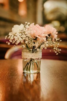 So cute. Jam jars, or mason jars instead of vases.
