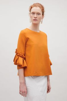 COS image 8 of Top with frill detailed sleeves in Orange