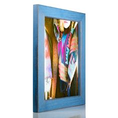 """Craig Frames Gesso, Blue Plain Wooden Picture Frame, 8.5 by 11-Inch. Shaker style; blue with neutral undertones; painted finish. Frame includes: glass, rigid black backing and pre-attached stamped hanging hardware. Frame holds a 8.5 inch by 11 inch photo/print (viewable area reduced by .25"""" on each side, due to frame lip). Frame moulding is 1.25 inches wide; solid Poplar wood. Made in the U.S.A."""