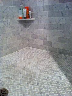 grey herringbone tile - Bathroom tile ideas will amp up your small bathroom with a touch of creativity and color Shower Floor Tile, Bathroom Floor Tiles, Room Tiles, Shower Walls, Stone Shower, Bathroom Green, Bathroom Colors, Grey Tile Shower, Neutral Bathroom Tile
