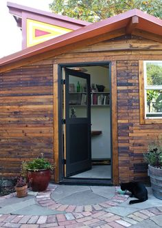 """On a quaint, tree-lined street in Berkeley, California, architect Sarah Deeds of Deeds Design and carpenter John McBride placed a 120-square-foot office/art studio near their main house, a renovated 1906 Victorian. """"It's like a little fort,"""" says Deeds. The studio's redwood siding was milled from trees salvaged from a road-widening project in Sonoma County, California.  Courtesy of: © Lenny Gonzalez 2010"""
