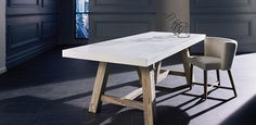 Solid Acacia frame with a concrete table top. Full range includes matching coffee and lamp tables