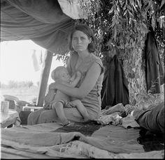 Drought refguees from Oklahoma camping by the roadside. They hope to work in the cotton fields. The official at the border (California-Arizona) inspection service said that on this day, August 17, 1936, twenty-three car loads and truck loads of migrant families out of the drought counties of Oklahoma and Arkansas had passed throught that station entering California up to 3 oclock in the afternoon. August, 1936.