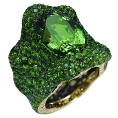 Savoyarde green ring by Fabergé~nearly flawless emerald center and emerald accent stones, as well as diamonds on the side of the shank.