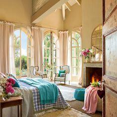 Bedroom, Bedroom Eduardo Arruga Design Hearth Shape Key Chain Two White Sofa Two White Carpet Green Blanket And Square Shape Blanket Flower In Vase On Fireplace: Pretty Bedroom That Blistering by Eduardo Arruga