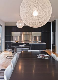 Wonderful Family House in Urban Style : Sleek Dining Area With Fancy Round Chandelier Lighthouse