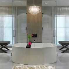 The ultimate his-and-hers ensuite bathroom separate bathing areas, designated dressing rooms and vanities.