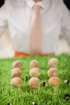 Love this for a golf theme! Donut holes in wheatgrass-lined trays|calder clark designs|harwell photography|old edwards inn