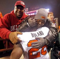 Oklahoma State's Desmond Roland (26) celebrates with fans after the 38-35 overtime win against Oklahoma during a Bedlam college football game between the University of Oklahoma Sooners (OU) and the Oklahoma State University Cowboys (OSU) at the Gaylord Family Oklahoma Memorial Stadium in Norman, Okla. on Saturday, Dec. 6, 2014. Photo by Chris Landsberger, The Oklahoman