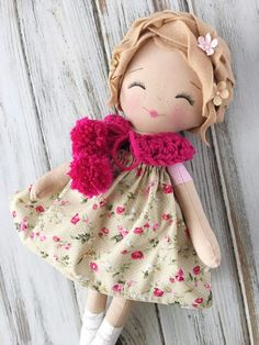 Dolls hair is made from light brown wool felt and is styled in a wavy Dutch girl braid accented with sweet flowers. Her outfit consists of an adorable floral print dress, a sweet pair of bloomers, a darling crochet tied collar and knee high booties.  Her face is hand-stitched and detailed with sweet, smiling eyes and soft, rosy cheeks.  Measures approximately 17 inches from head to toe and comes beautifully boxed and gift wrapped. PLEASE NOTE ❤  Dolls are made with small materials and…
