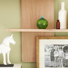 Simple open shelves provide clean-look storage and warm, contemporary style. DIY this shelving in a weekend!