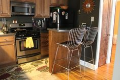 Decoration  Fascinating Wire Chairs Also Floral Kitchen Rug On Laminate Floor Plus Brown Wall Paint Color Background Sweet Rugs adorns your Nice Kitchen Decor