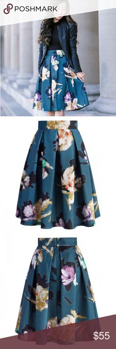 """Floral Pleated Skirt With pleats and flowers, this Floral Illusion skirt in teal is a fun way to add a splash of color and foliage to your new spring wardrobe! Tuck in a chiffon top and step into heels for a formal occasion. Go for a playful graphic tee and flats for a super chill but equally chic look. Back zip closure. 100% Polyester. Machine washable. As seen on Extra Petite blogger. Same print/material as Anthropologie's Baikal Dress by Moulinette Soeurs. Waist 16"""", Length 24"""". New…"""