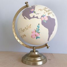 This listing is for a custom hand painted and hand lettered 8 diameter desktop globe with floral arrangement accents. Globes are ideal for weddings, anniversary, graduation, birthday, job promotion, new job congratulations, nursery, house warming, or going away party for friends and family to sign and/or home decor.  *Pictured with ivory oceans, mauve continents, floral arrangements outlined in gold, gold lettering and gold stand. **8 holds approximately 75 guest signatures**  Globes are made...