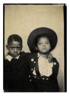 +~ Vintage Photo Booth Picture ~+  Brothers not looking too thrilled about having their picture taken together.