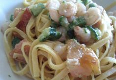 Tagliolini with zucchini, shrimps and tomato