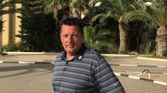 Briton Colin Bidwell makes an emotional return to Tunisia, a year after he and his wife had to run for their lives when a gunman opened fire on a beach, killing 38 tourists.