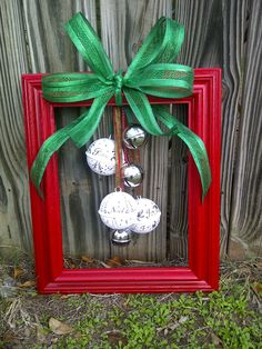 "Christmas door ""wreath"" or wall decor:  frame, painted with Christmas bells and sparkle ribbon added. Would be cute for any season with different colors and hanging items!"