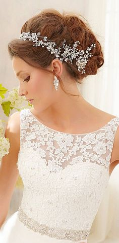 LOVE THE TOP OF THIS WEDDING DRESS!!! LOVE THIS HEADPIECE TOO!!! <3 :-) wedding dress. Love the lace on top. I'm not too crazy about the headpiece though