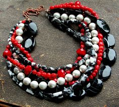 Six strands of gems and pearls such as highly polished ebony sardonyx ovals, faceted and smooth mexican jasper beads, lustrous south sea shell pearls spaced with tiny seed beads, stop-light red coral nuggets with lg faceted AAA grade crystals...